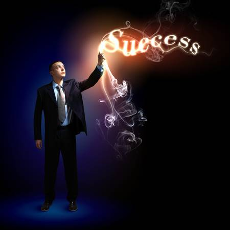 Young successful businessman holding a shining light in his hand as a symbol of success and advancement  Stock Photo - 16616045