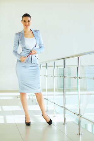 Portrait of happy smiling young businesswoman in office Stock Photo - 16548792
