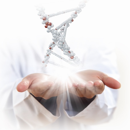 Image of DNA strand against background with human hands photo