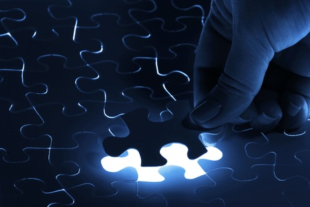 puzzle piece coming down into its place Stock Photo - 16524911