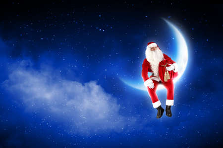 a Santa Claus sitting on shiny moon above winter forest Stock Photo - 16548845