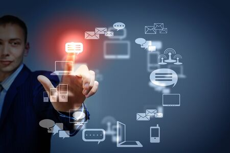 Business person pushing symbols on a touch screen interface Stock Photo - 16548803