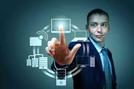 Business person pushing symbols on a touch screen interface Stock Photo - 16548783