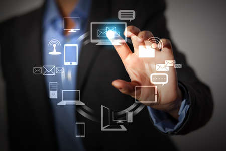 Business person pushing symbols on a touch screen interface Stock Photo - 16524724