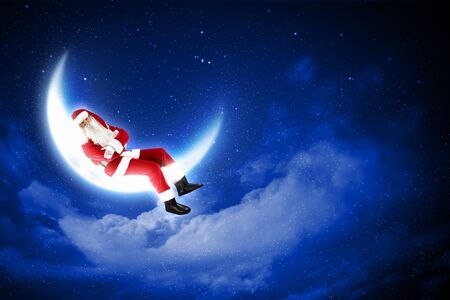 christmasbackground: a Santa Claus sitting on shiny moon above winter forest