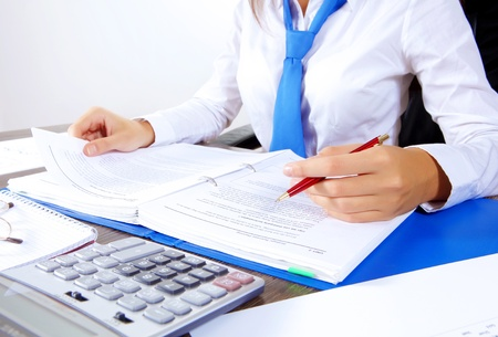 accounting: Business woman at office sitting at table and working Stock Photo