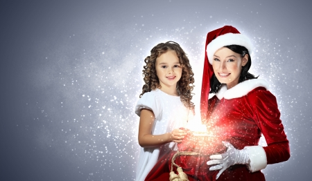 Christmas illlustration of little girl with christmas gifts and santa photo