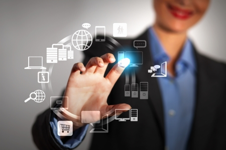 Business person pushing symbols on a touch screen interface Stock Photo - 16548785