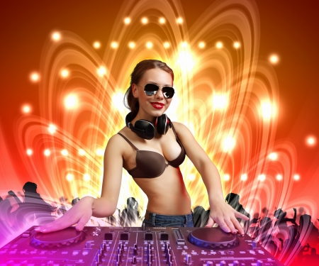 DJ with a mixer equipment to control sound and play music photo
