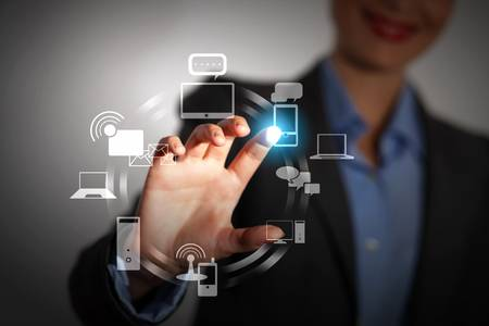 Business person pushing symbols on a touch screen interface Stock Photo - 16577872