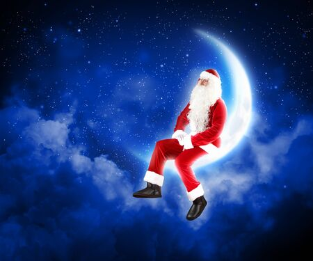 Photo of Santa Claus sitting on shiny moon above winter forest Stock Photo - 16589022