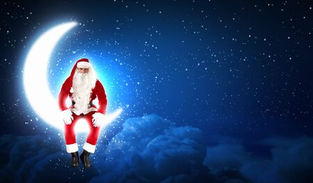 Photo of Santa Claus sitting on shiny moon above winter forest Stock Photo - 16589016