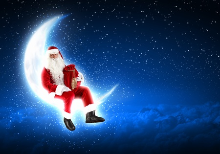 Photo of Santa Claus sitting on shiny moon above winter forest Stock Photo - 16589788