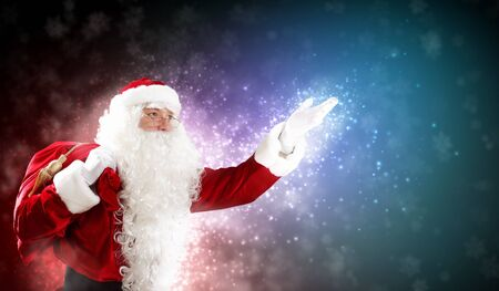 Christmas theme with Santa holding magical lights in hands Stock Photo - 16616373