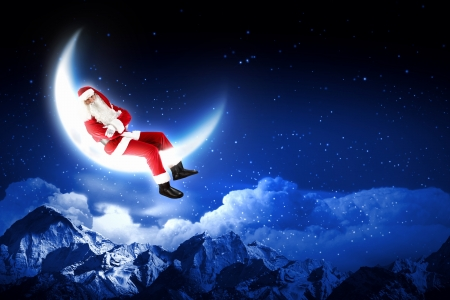 Santa Claus sitting on shiny moon above winter forest Stock Photo - 16616690