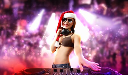 Young brunette woman in christmas wear with earphones Stock Photo - 16655159