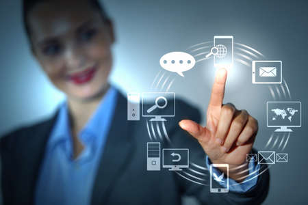 Business person pushing symbols on a touch screen interface Stock Photo - 16616620