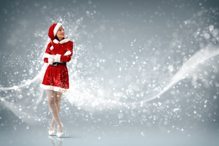 christmas girl: Portrait of beautiful young woman wearing santa claus clothes