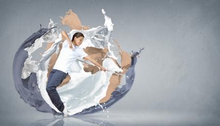Modern style dancer jumping and paint splashes Illustration illustration