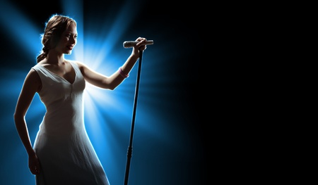Female singer on the stage holding a microphone Stock Photo - 16655174