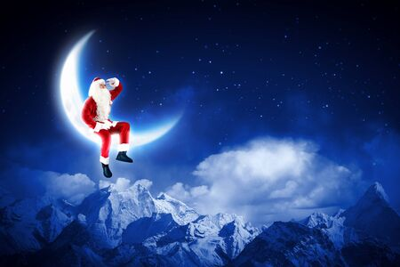 Santa Claus sitting on shiny moon above winter forest Stock Photo - 16616689