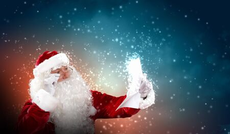 Santa holding Christmas letters and looking at camera Stock Photo - 16655165