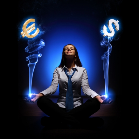 Businesswoman with financial symbols around her on the background photo
