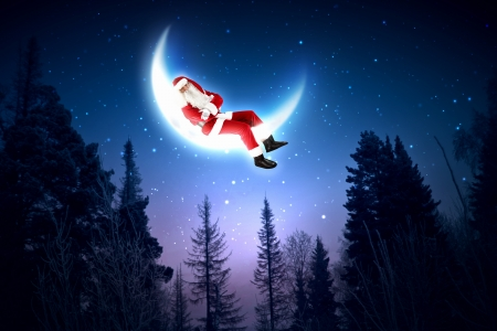 christmasbackground:  Santa Claus sitting on shiny moon above winter forest Stock Photo