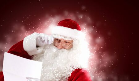 Santa holding Christmas letters and looking at camera Stock Photo - 16690438