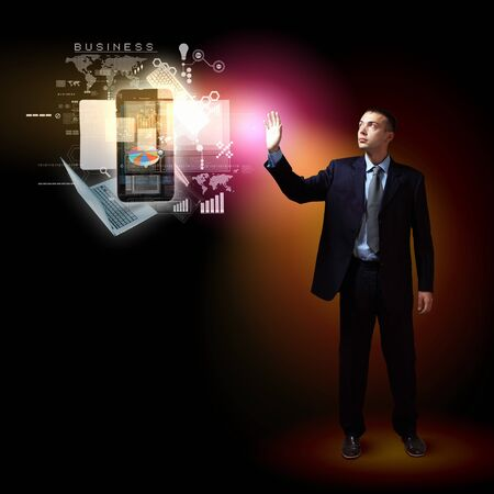 Businessman standing with modern technology symbols next to him Stock Photo - 16690341