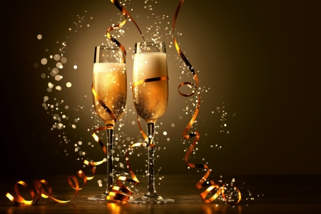 congratulation card: Two champagne glasses ready to bring in the New Year