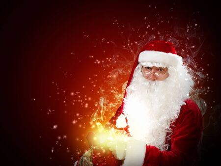 father Christmas carrying presents in his sack Stock Photo - 16690455