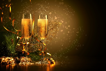 new years eve background: Two champagne glasses ready to bring in the New Year
