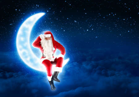 Photo of Santa Claus sitting on shiny moon above winter forest Stock Photo - 16690342