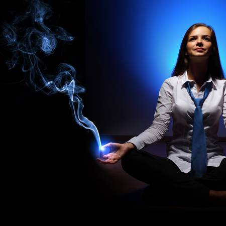 Young business woman sitting in asana lotus and meditating Stock Photo - 16732183