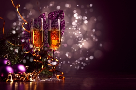 new year background: Two champagne glasses ready to bring in the New Year