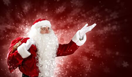 fulfillment: Christmas theme with Santa holding magical lights in hands