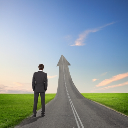 Concept of the road to success with a businessman standing on the road Stock Photo - 16648918