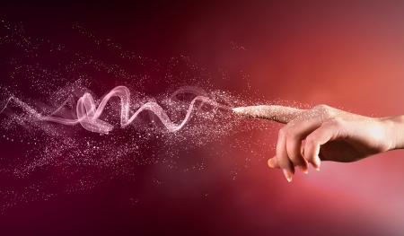 handdrawn: magical hand conceptual image with sparkles on colour background