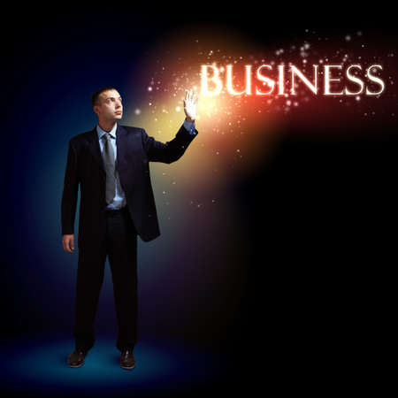 Young successful businessman holding a shining light in his hand as a symbol of success and advancement  Stock Photo - 16648512
