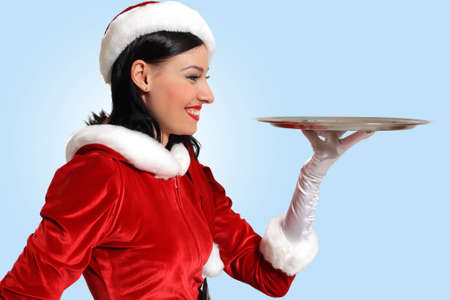 Excited Santa Girl presenting your product, lots of copy-space