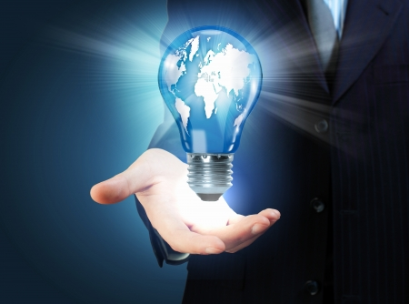 Hand with lamp and hands of a business person Stock Photo - 16648653