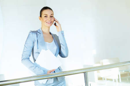 Portrait of happy smiling young businesswoman in office Stock Photo - 16716417
