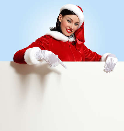 Portrait of a santa girl with a blank banner Stock Photo - 16716358