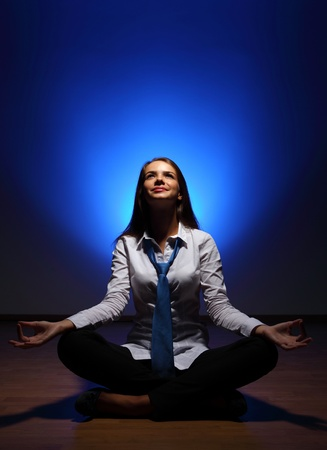 Young business woman sitting in asana lotus and meditating Stock Photo - 16716307