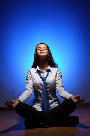 Young business woman sitting in asana lotus and meditating Stock Photo - 16716315