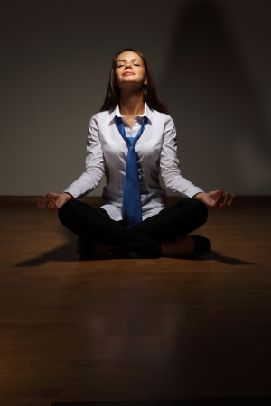Young business woman sitting in asana lotus and meditating Stock Photo - 16716366