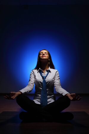 Young business woman sitting in asana lotus and meditating Stock Photo - 16716361
