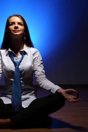 Young business woman sitting in asana lotus and meditating Stock Photo - 16716316