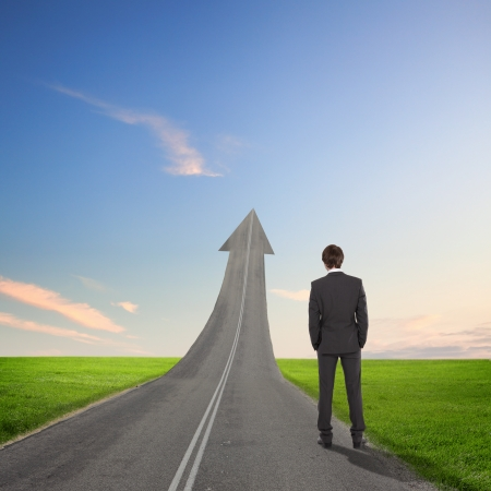 Concept of the road to success with a businessman standing on the road Stock Photo - 16751863